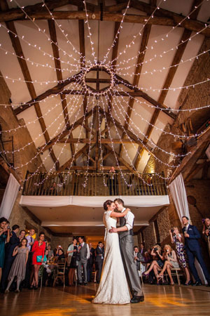 image: Jo & Mark's first dance at The Great Tythe Barn, Tetbury.