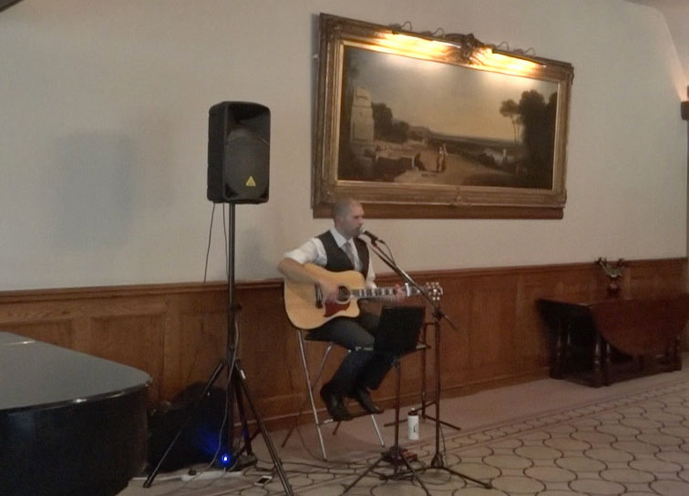 image: Castle Combe wedding ceremony guitarist
